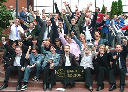 Members of the Hoover (Bolton) Band celebrating outside the Harrogate Conference Centre