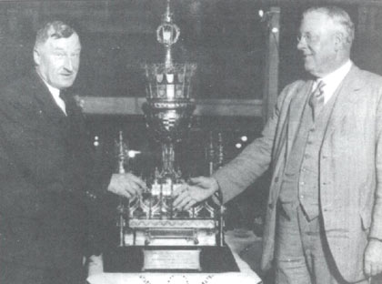 Fodens being presented with the .trophy in 1930 E. R.  Foden receives the cup from John Henry Iles