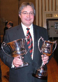 Dr Robert Childs holds the trophy