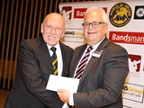 4th Carlton Main and Ray Sykes receives cheque from John Woods